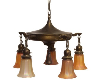 Five light brass chandelier with art glass shades