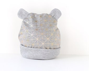 Baby / Toddler beanie hat with ears in modern gold geometric pattern.