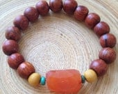Carnelian mala bracelet with rosewood, sandalwood, and turquoise stretch stacking bracelet