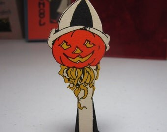 1920's unused die cut colorful halloween die cut party decoration for place cards cupcakes etc. jack o'lantern in a party hat and ribbons
