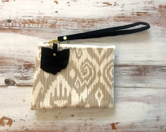 Tan ikat clutch with recycled leather wristlet and ohio bag charm