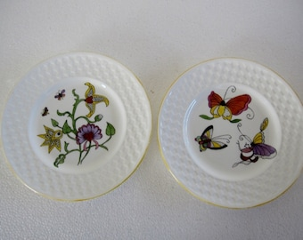 Hand painted with abstract flowers and butterflies pair of Wedgwood small plates