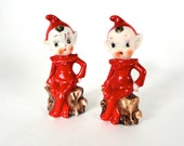 Vintage Elf Figurines, Set of Two Porcelain Pixie Minature Christmas Elves, Made in Japan, Red Elves Sitting on Tree Stumps
