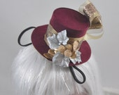 Steampunk Burgundy Mini Top Hat with gold and burgundy ribbon, silver leaves, and gold leaves with berries OOAK