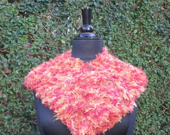 Buttoned cowl in oranges and gold eyelash yarn