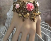 Antiqued Brass Filigree and Roses With Charms Romantic Bracelet