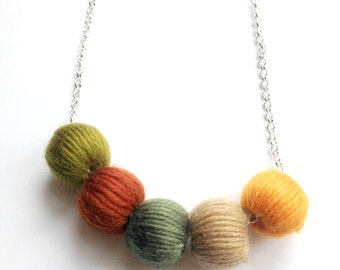 Brown and Green 'wool ball' necklace - fall autumn leaf fibre