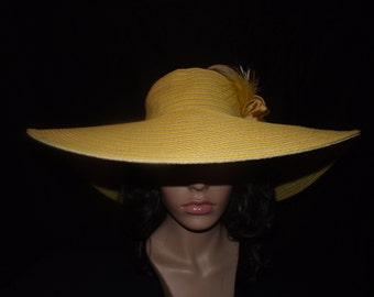 Yellow and tan striped wide brimmed womans summer hat