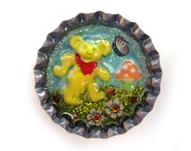 Grateful Dead dancing bear hat pin, handmade and one of a kind, enamelled bear in bottlecap with mushroom, butterfly and flower, lacquered