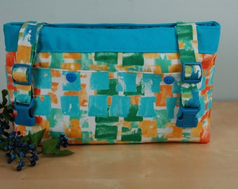 Powerchair - Walker Bag:  NEW Fabric Design featuring Bright Touches of Turquoise, Green, Orange and Gold with a Turquoise Lining.