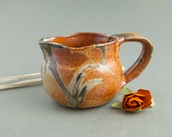 Rust and black creamer, pitcher