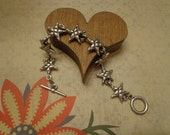 "New Old Stock Circa 1960s Puffy Star Matte Silver Tone Link Bracelet w/ Toggle Clasp, 7 3/4"", Korea"
