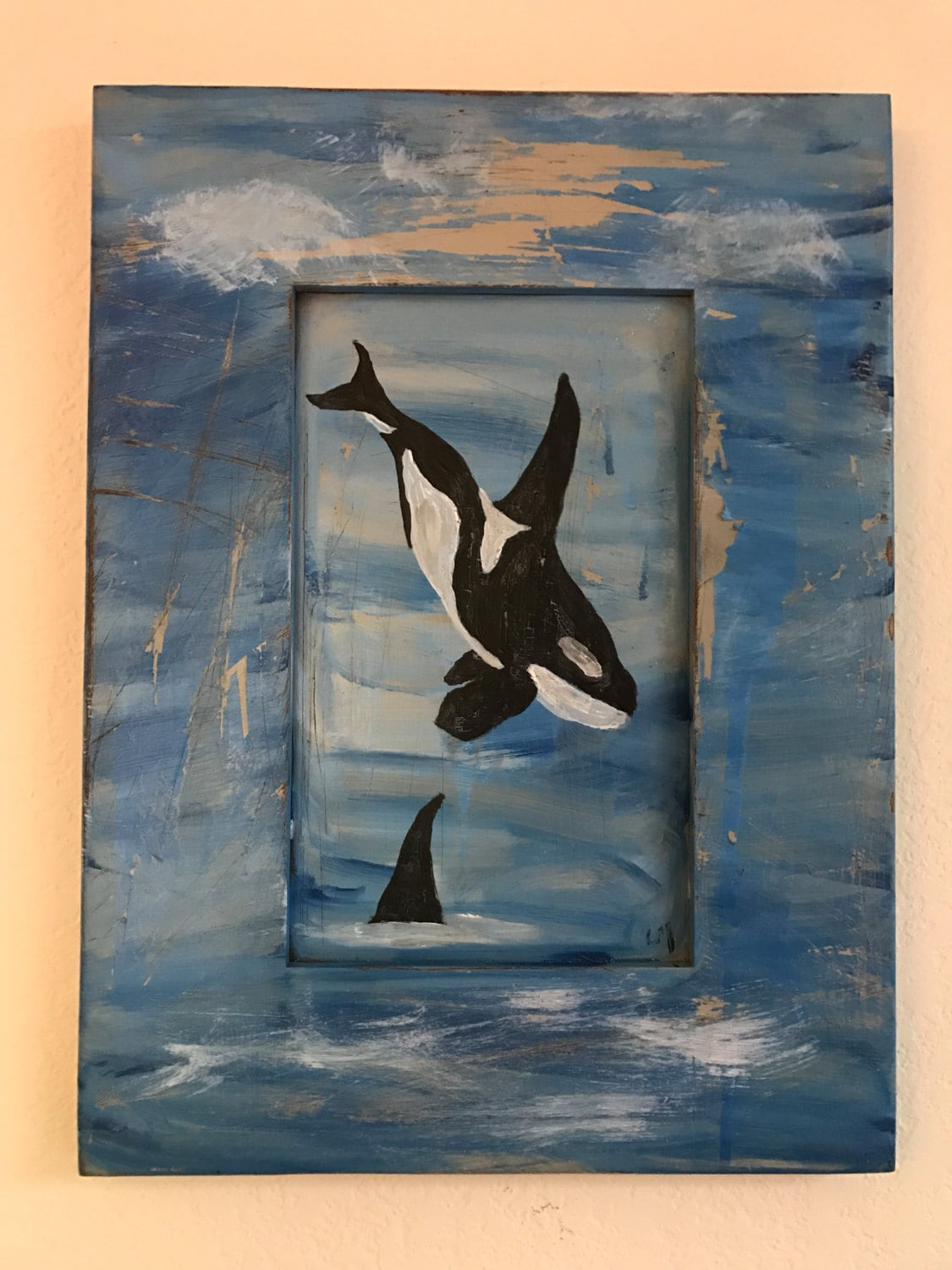 Orcas on distessed wood cabinet