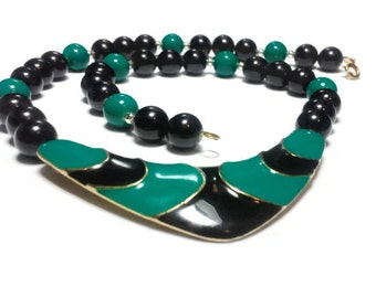 Green and black choker, green and black enamel center with gold lines, then alternating black and green beads and silver spacer beads