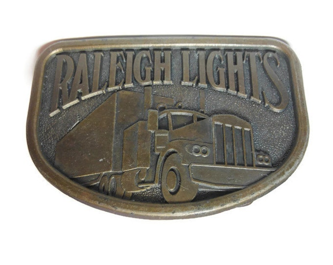 FREE SHIPPING Raleigh Lights belt buckle, brass western belt buckle, showing truck, trucker belt buckle vintage