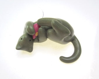 Little cat Ricky with toy mouse polymer clay sculpture sage green sparkly decoration hand made OOAK