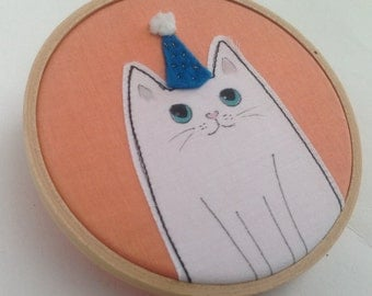 White cat hoop art. Cat in a party hat wall decor, cat lover gift, fun cat  art