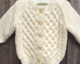 Baby girl hand knitted cream cardigan