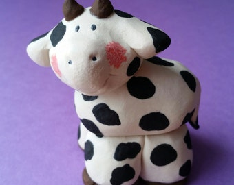 Clay Cow Sculpture