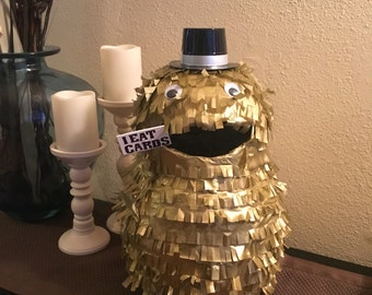 Card Eating Monster Pinata - gold w hat and sign