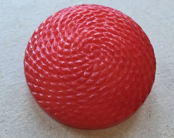 bright beautiful red vintage eco friendly domed round shank coat button with spiraling textured surface design