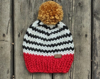 Bright red with black and white stripes chunky knit toddler hat with mustard yellow pompom
