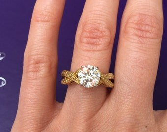 1.5 carat SI1 clarity certified diamond Engagement Ring. 18K yellow gold. Offering flexible no interest layaway.