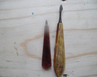 2 Vintage Bakelite manicure pieces one has pearlized top and design,,,
