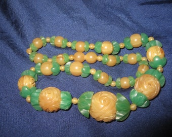 Art Deco carved lucite early plastic necklace