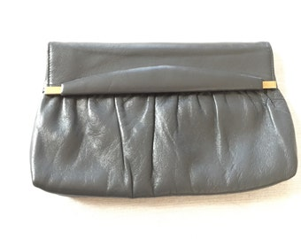 Vintage gray leather clutch with small brass details fold over with snap closure