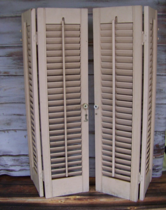 Vintage shutters home decor beige wooden window shutters for Decorating with plantation shutters