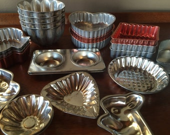 Fabulous tart tins and jello molds...  21 in all.
