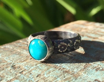 Silver turquoise ring adorned with flowers