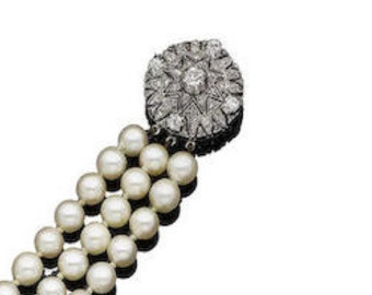 Three strand pearl necklace with Diamond clasp