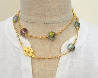 Gold beaded chain necklace with green glass bead and eternity knot stations Convertible one or two strands