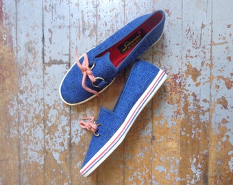 blue canvas slip on sneakers/ decorative laces/ buckles/ red white blue// size 6