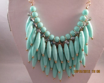 4 Row Layered Bib Necklace with Turquoise Beads on a Gold Tone Chain