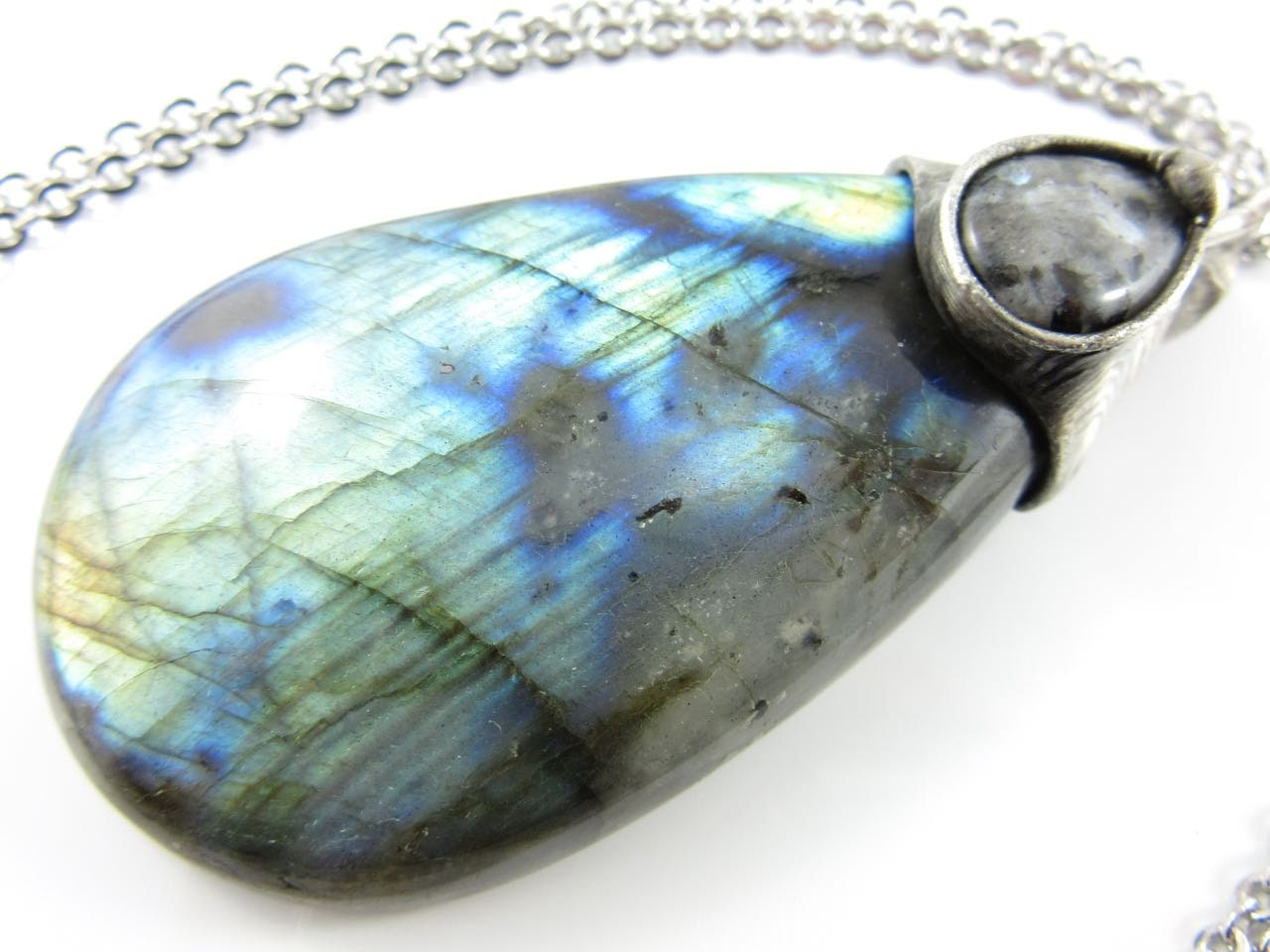 the magi black moonstone & labradorite crystal pendant