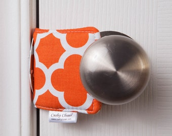 The Original Cushy Closer Door Cushion - Orange & White Quatrefoil - Door Latch Cover