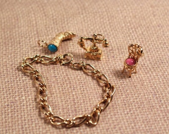 Avon Gold Tone Charm Bracelet with Three Charms - Vintage 1973