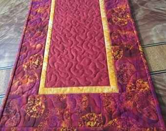 Beautiful red and tangerine leafy quilted table runner
