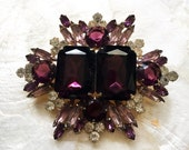 Large purple blingy brooch is not for the faint of heart
