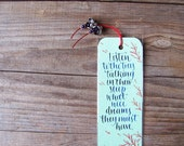 Lucy Maud Montgomery bookmark with quote from Anne of Green Gables in calligraphy. Listen to the trees