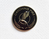 Hunger Games Catching Fire Mockingjay Metal Needle Minder