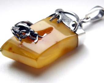 Baltic amber sterling silver bug pendant