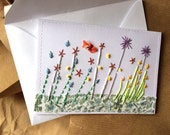 Hand-embroidered textile greetings card with vintage fabric