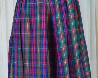 1960s plaid vintage skirt. Blues, purples, and greys. Rockabilly, feminine, sporty.