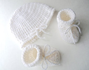 Crocheted white hat and bootie unisex set with adjustable ties hand crocheted in a soft white yarn