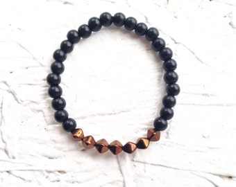 Black glass bead bracelet with dark copper faceted focal beads