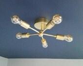 The Pinwheel Ceiling-Mount Light Fixture - modern brass sconce - brass wall-mount light - modern sconce - minimalist sconce